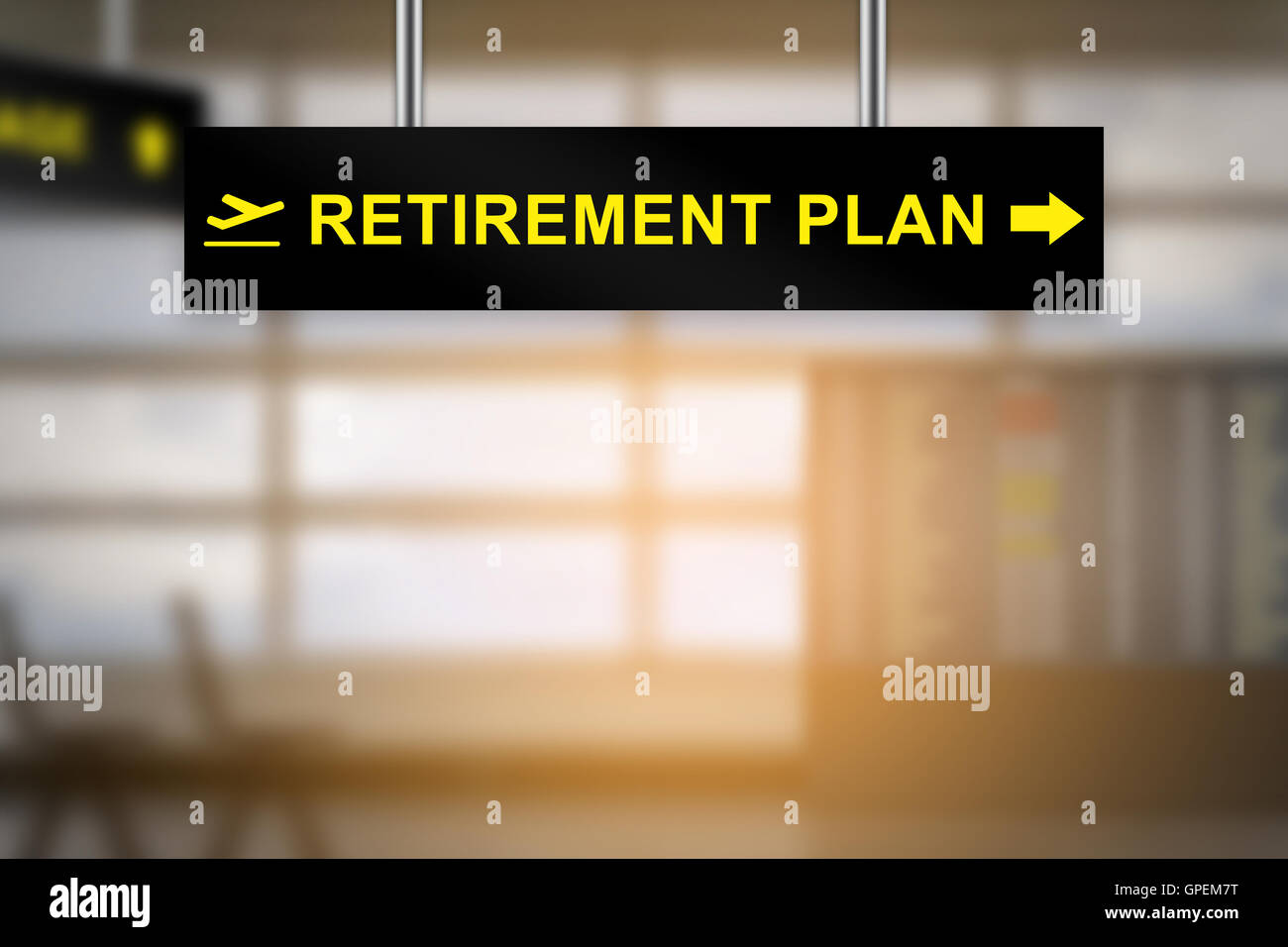 retirement plan on airport sign board with blurred background and copy space - Stock Image