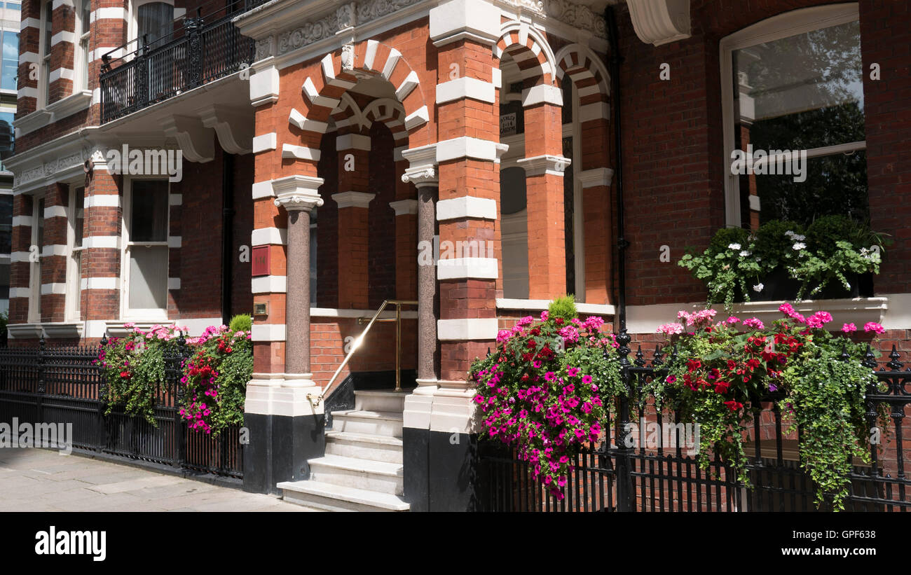 Mansion Block Red Brick Building  in VIctoria London SW1 - Stock Image