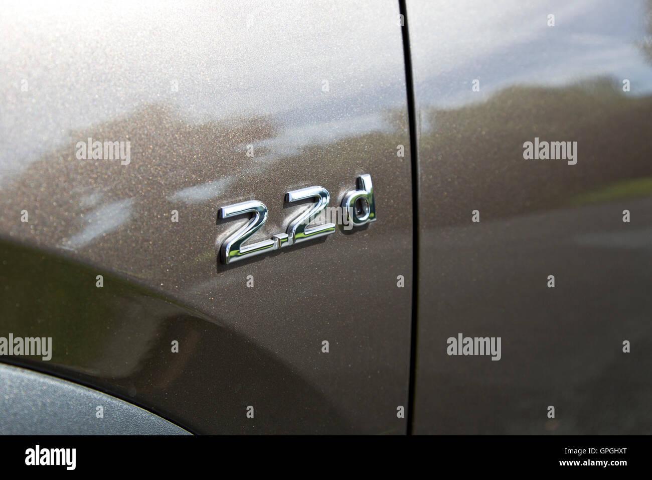 2.2d badge Infiniti chestnut bronze QX30 car. - Stock Image