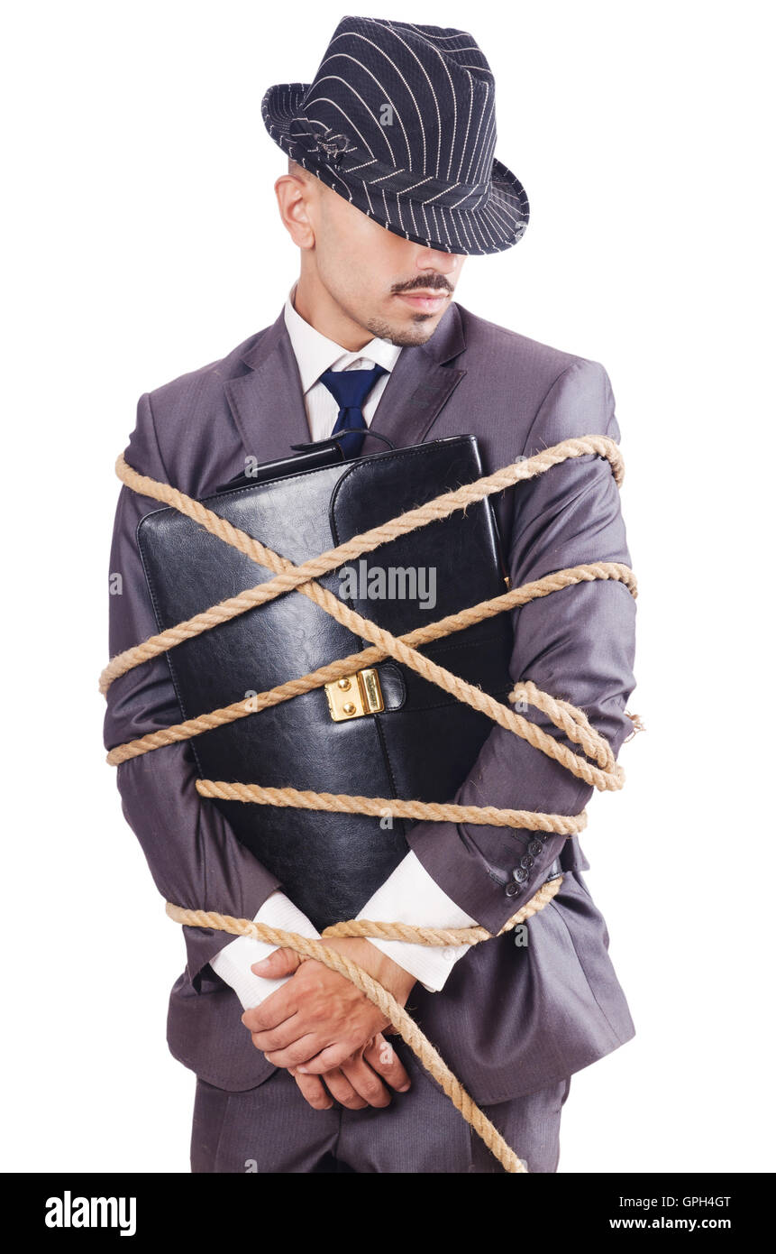 Man tied up with rope on white - Stock Image