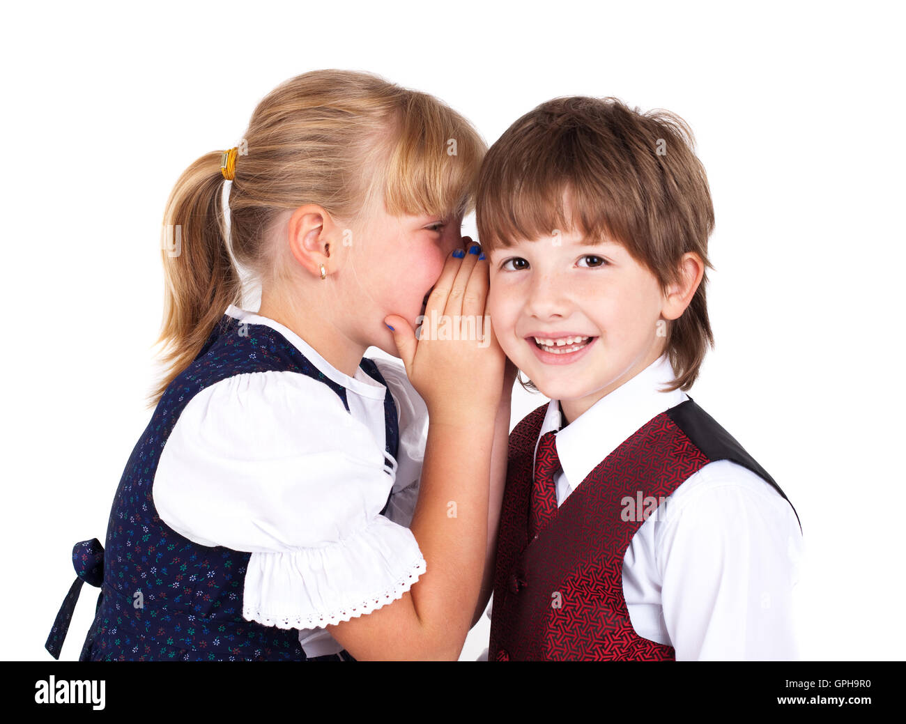 Two little kids telling secrets - Stock Image