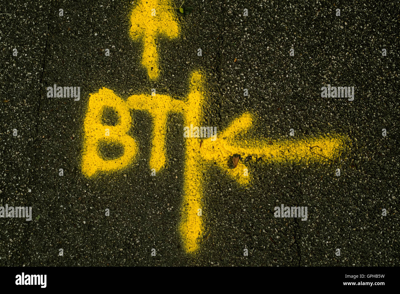 Markings on the pavement to indicate to BT engineers to carry out work - Stock Image