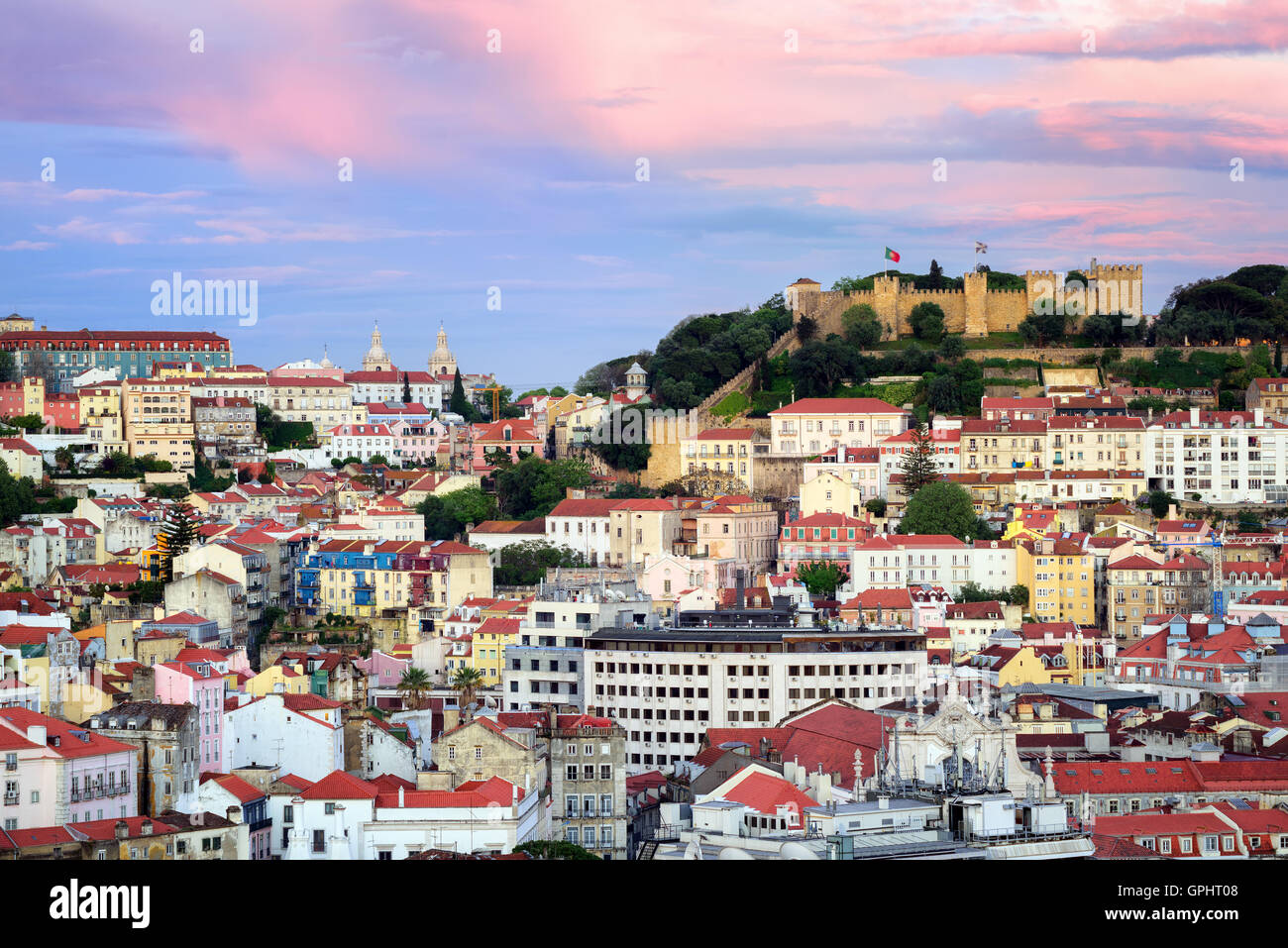 Lisbon, Portugal, view to the Alfama quarter and St. Jorge Castle at sunset - Stock Image
