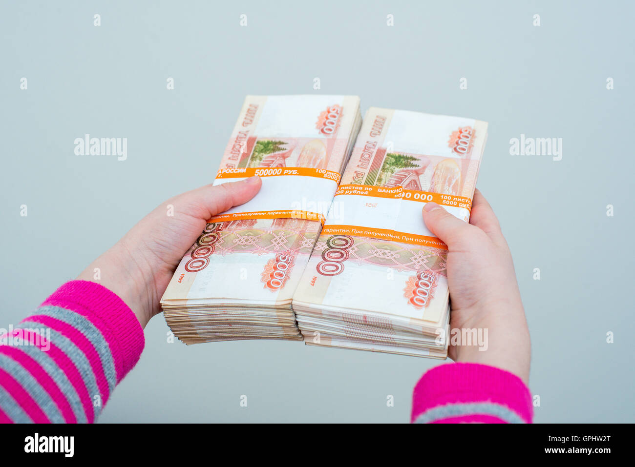 closeup human's hands holding russian rubles - Stock Image