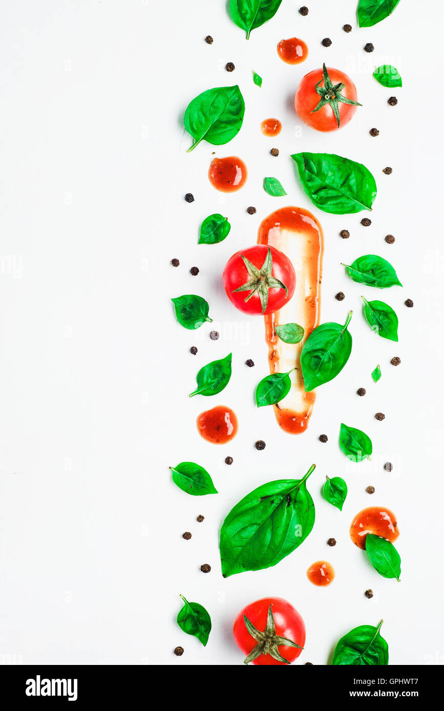 Basil pattern with tomatoes - Stock Image