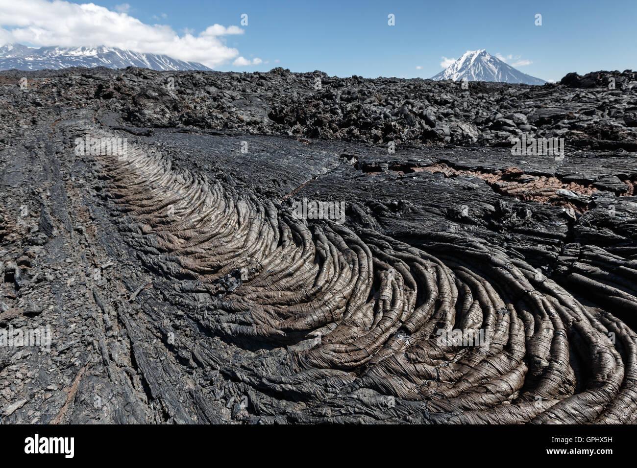 Volcanic landscape of Kamchatka Peninsula: beautiful view of lava field volcanic eruption active Plosky Tolbachik - Stock Image