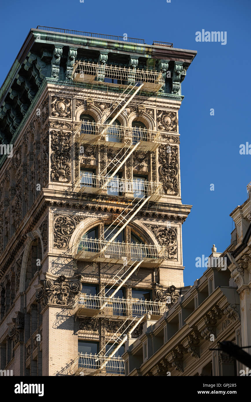 Soho building with intricate facade, terracotta ornamentation, copper cornice and painted iron fire escape. Manhattan, - Stock Image