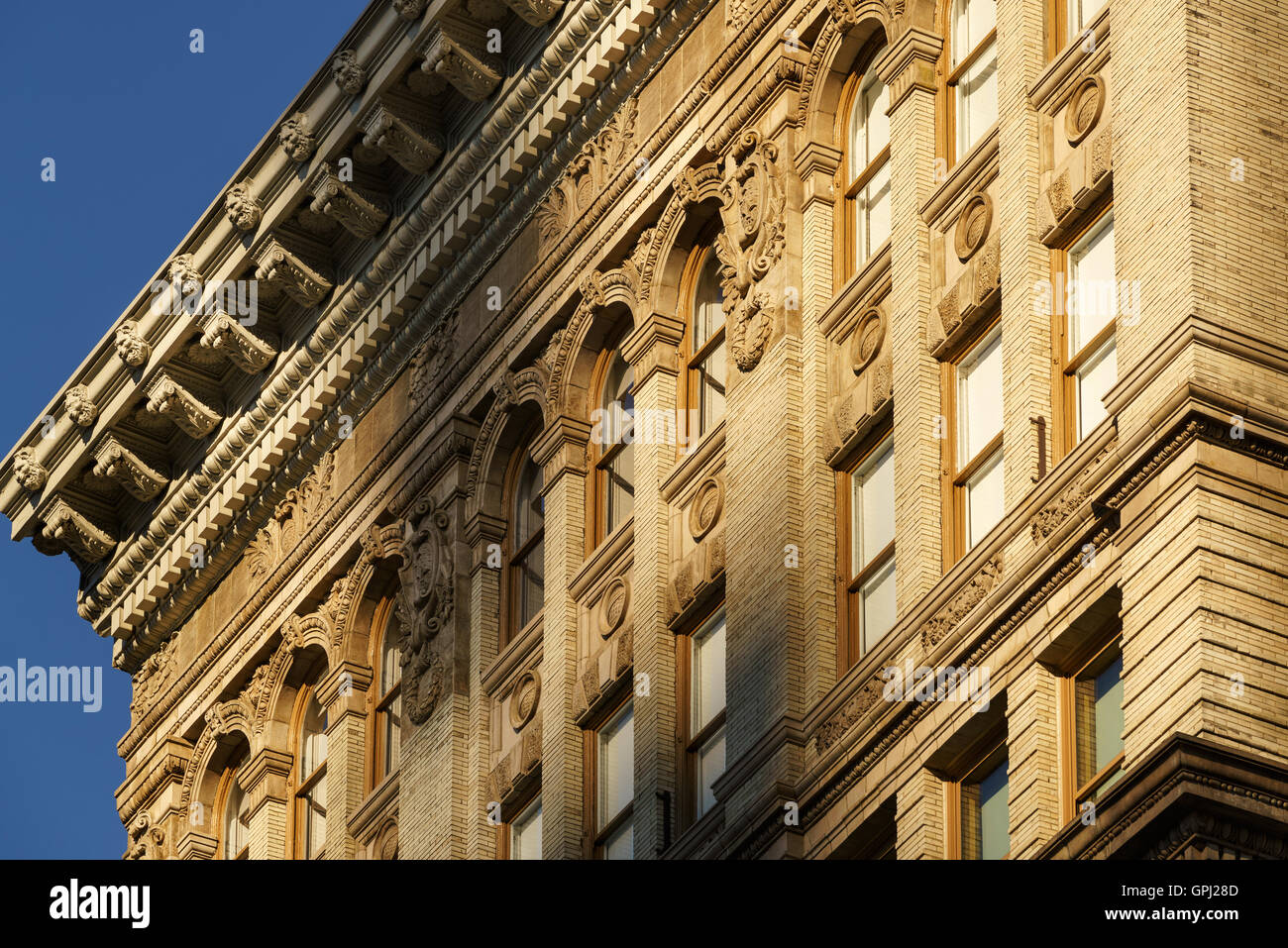 Soho brick building facades and cornices with terracotta architectural ornaments. Manhattan, New York City - Stock Image