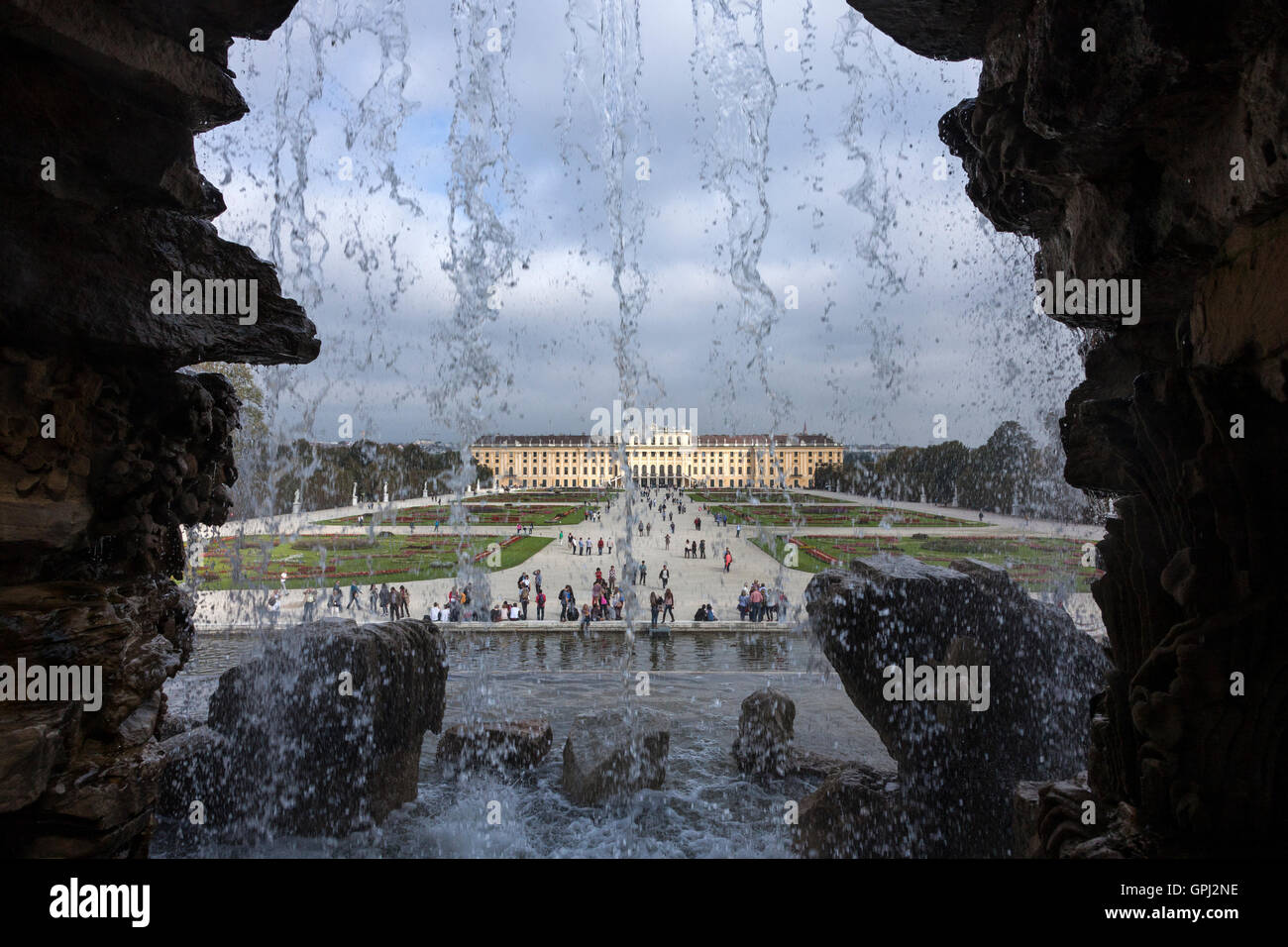 View to Schönbrunn Palace from behind the Neptune fountain in Vienna, Austria - Stock Image