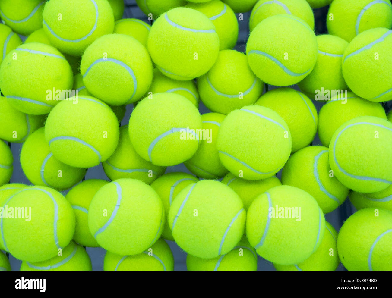 046b9c0bf9e9 lot of bright yellow tennis balls as a background Stock Photo ...