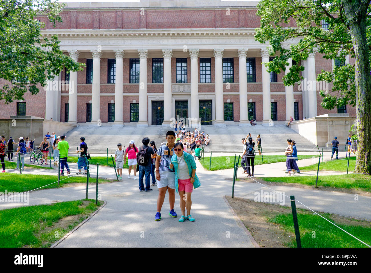 Tourists taking selfies in front of Harry Elkins Widener Memorial Library,  Harvard Yard of the Harvard University, - Stock Image