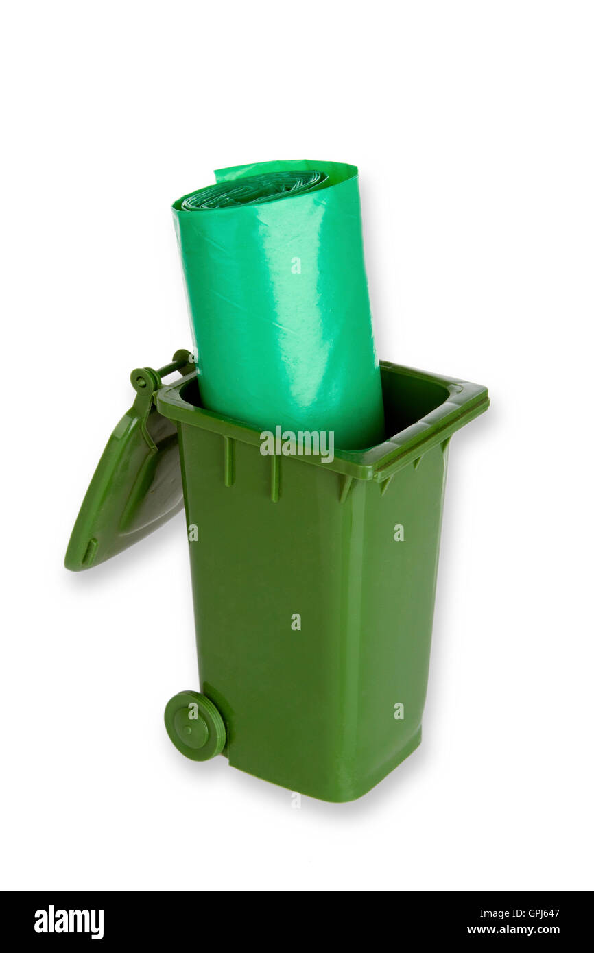 Garbage can with trash bags isolated on white background Stock Photo