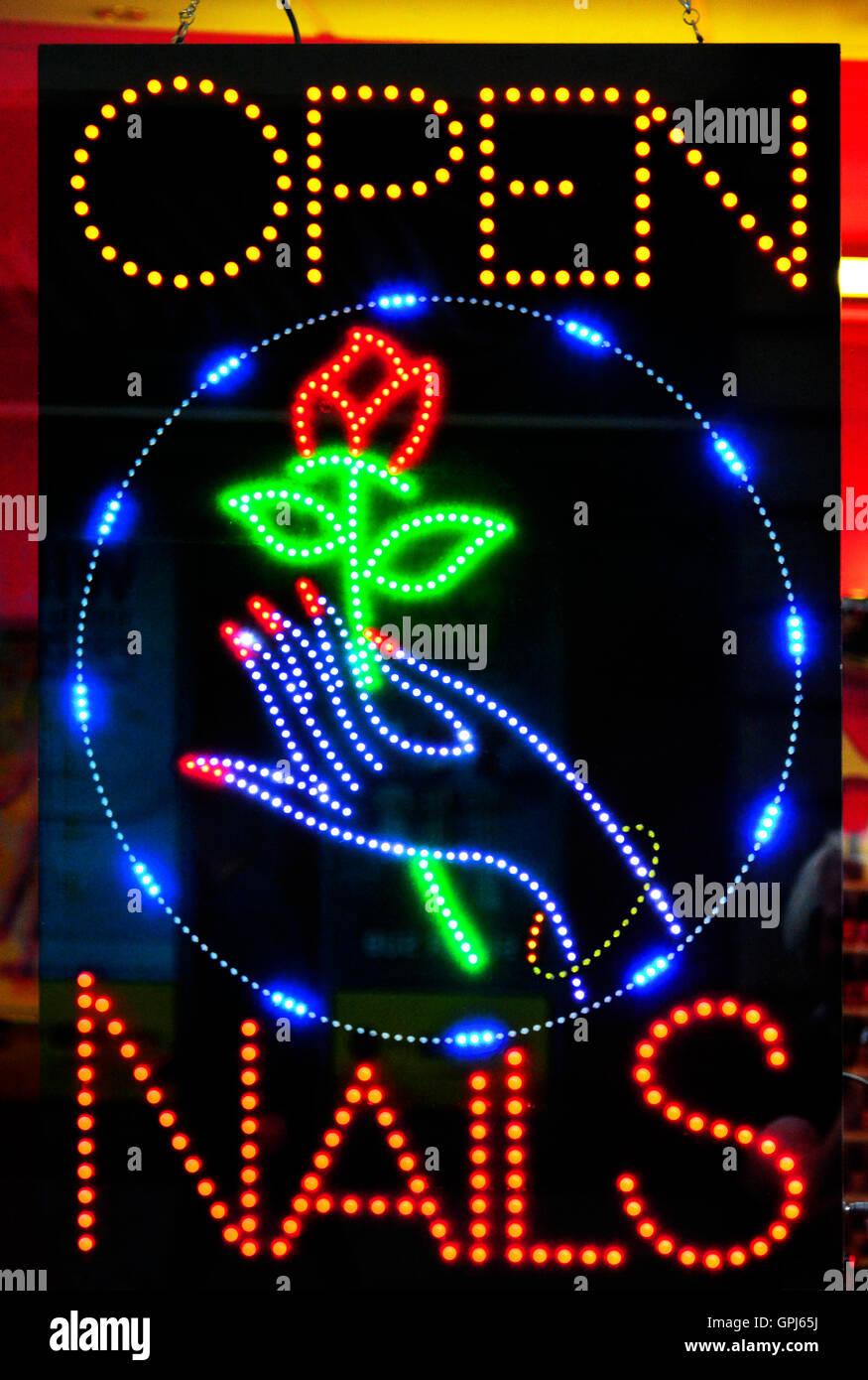 Beauty treatment nail decoration shop neon sign Stock Photo ...