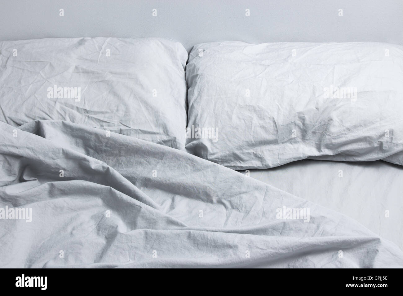 Gray bed linen - Stock Image