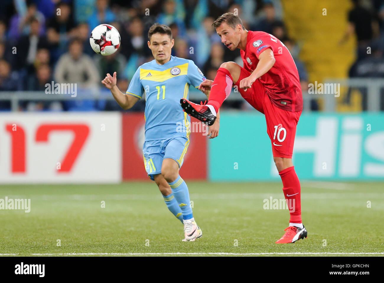 Astana, Kazakhstan. 4th September, 2016. Grzegorz Krychowiak (POL), Serikzhan Muzhikov (KAZ), Kazakhstan versus Poland, FIFA World Cup 2018 qualifier. The game ended in a 2-2 draw Credit:  Action Plus Sports Images/Alamy Live News Stock Photo