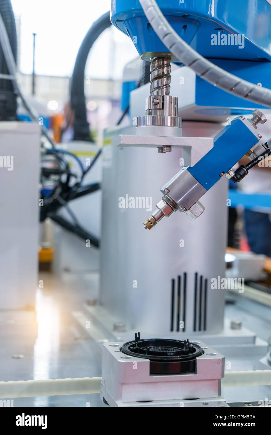 Robotic arm at production line in factory Stock Photo