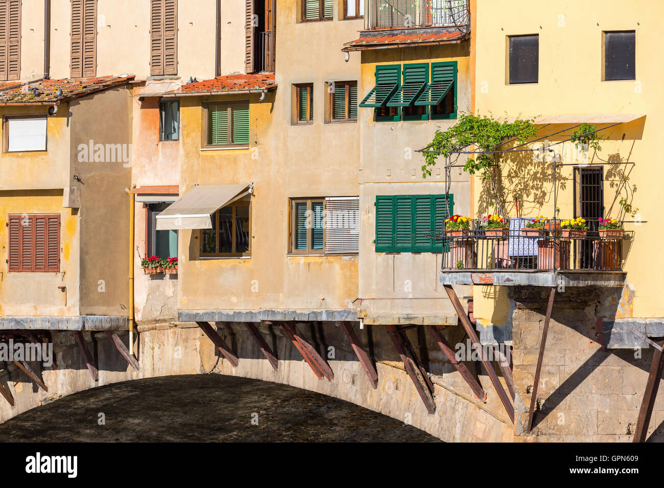 Residential building with a balcony with flowers - Stock Image