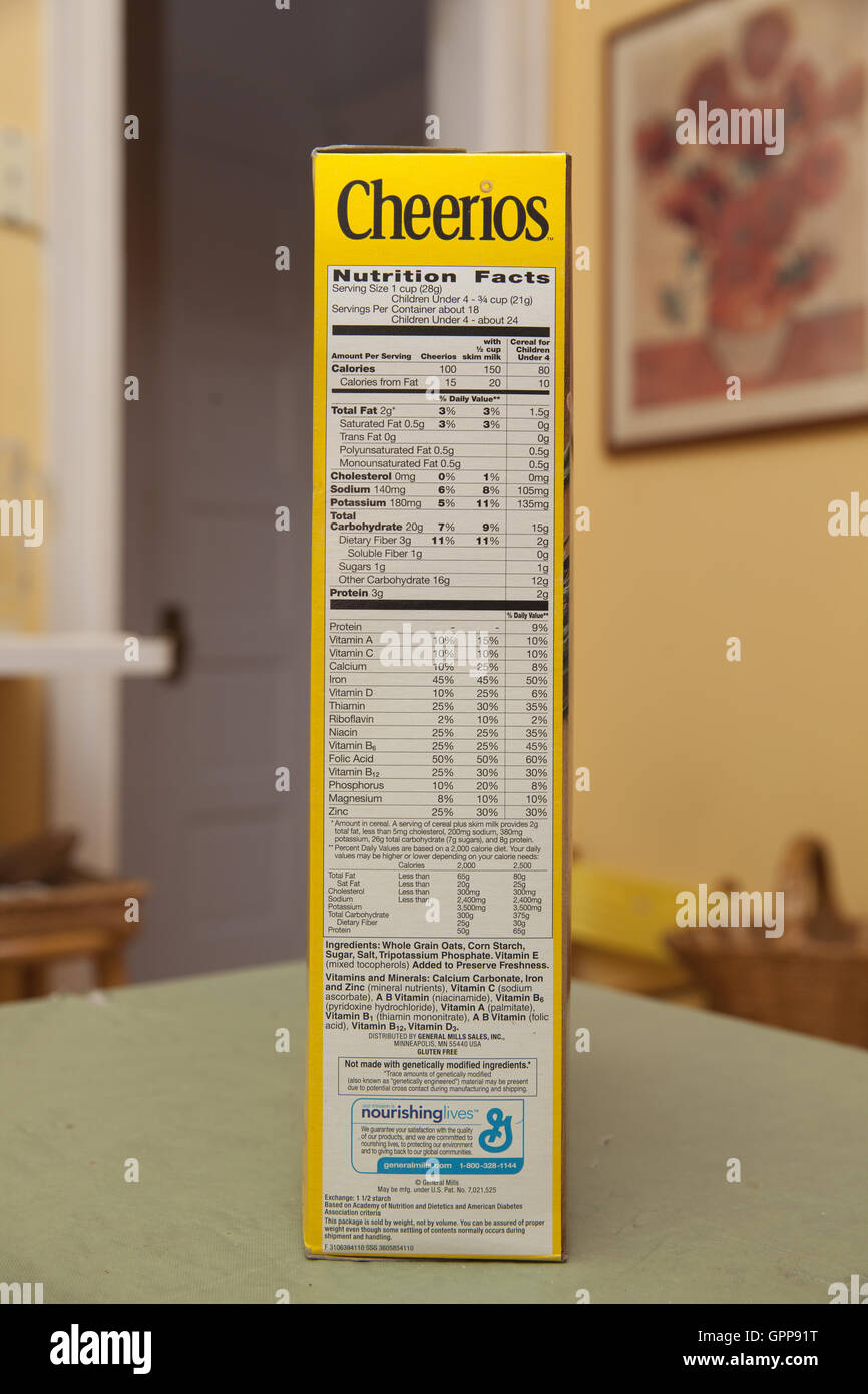 Nutritional facts listed on the side of a box of Cheerios. - Stock Image