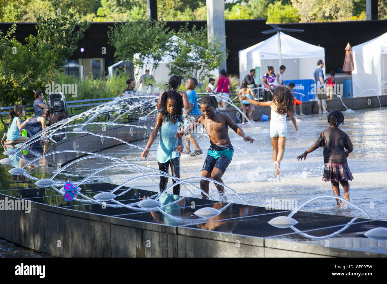 Children have fun and cool off during the summer heat wave  2016 at the LeFrak Center at Lakeside summer water park - Stock Image