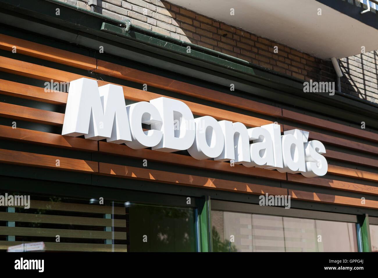McDonald's sign, McDonald's is the world's largest chain of hamburger fast food restaurants, serving around 68 million Stock Photo