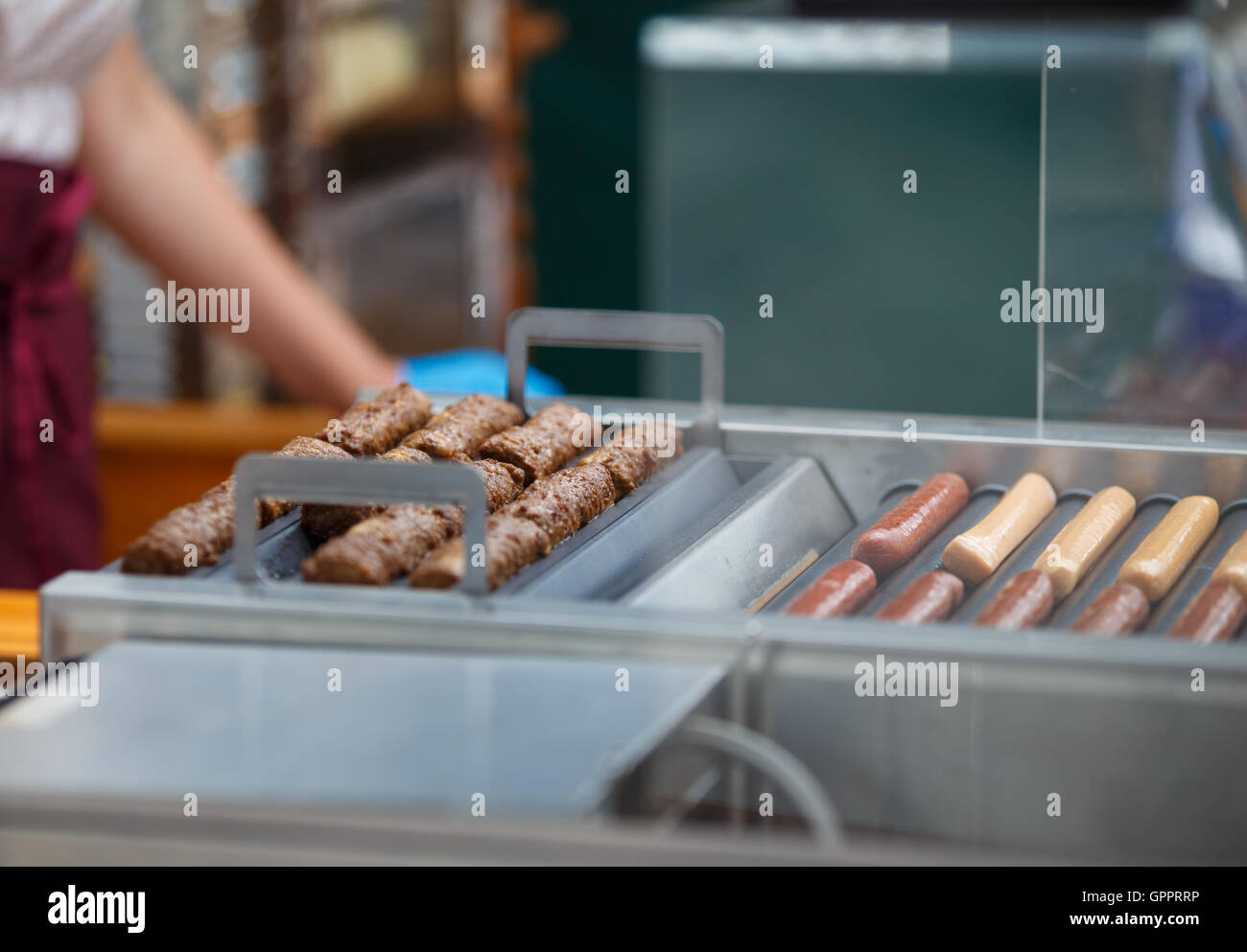 Frankfurters and sausages for hot dogs roasted on the grill. Street foodStock Photo