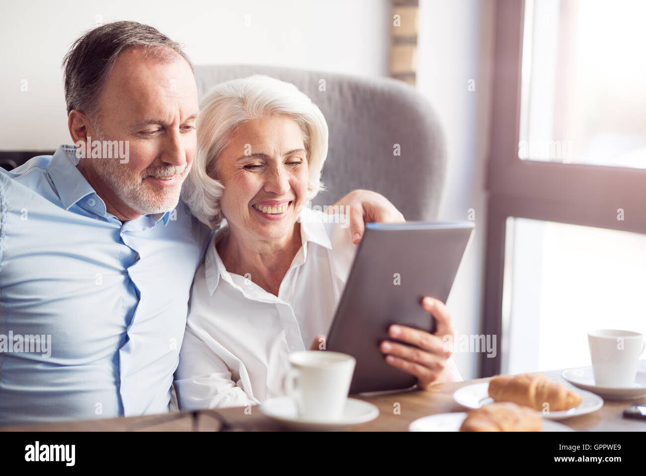 Cheerful couple resting in the cafe - Stock Image