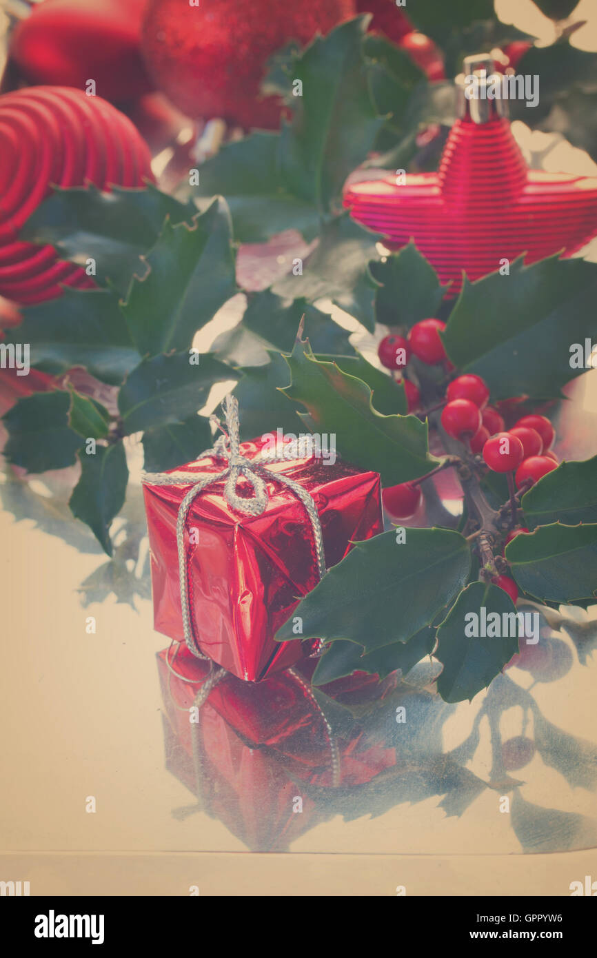 Holly  green leaves and red berries - Stock Image