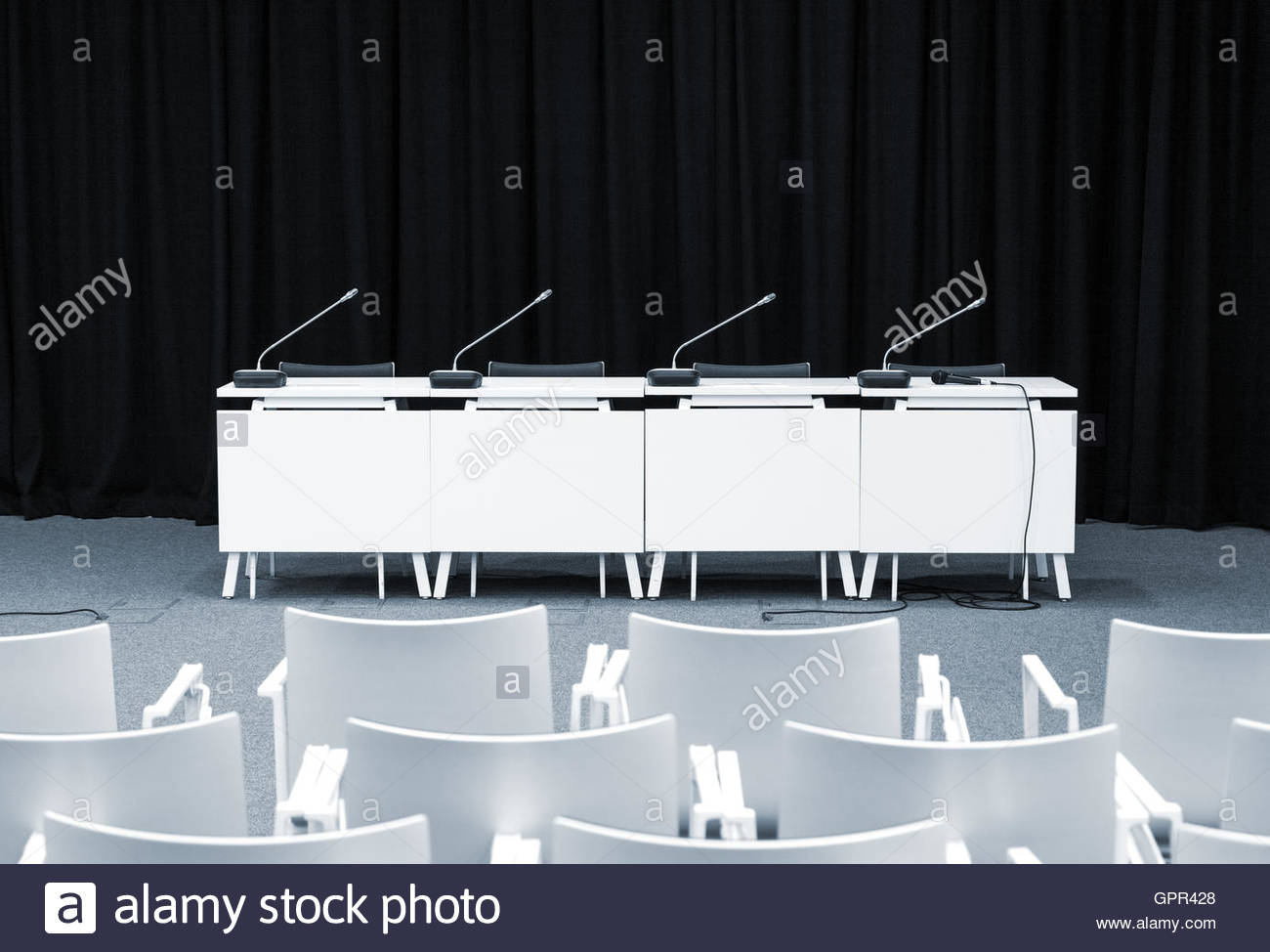 Monochrome Picture Of Empty Press Conference Room With Seats Stand - Conference table football