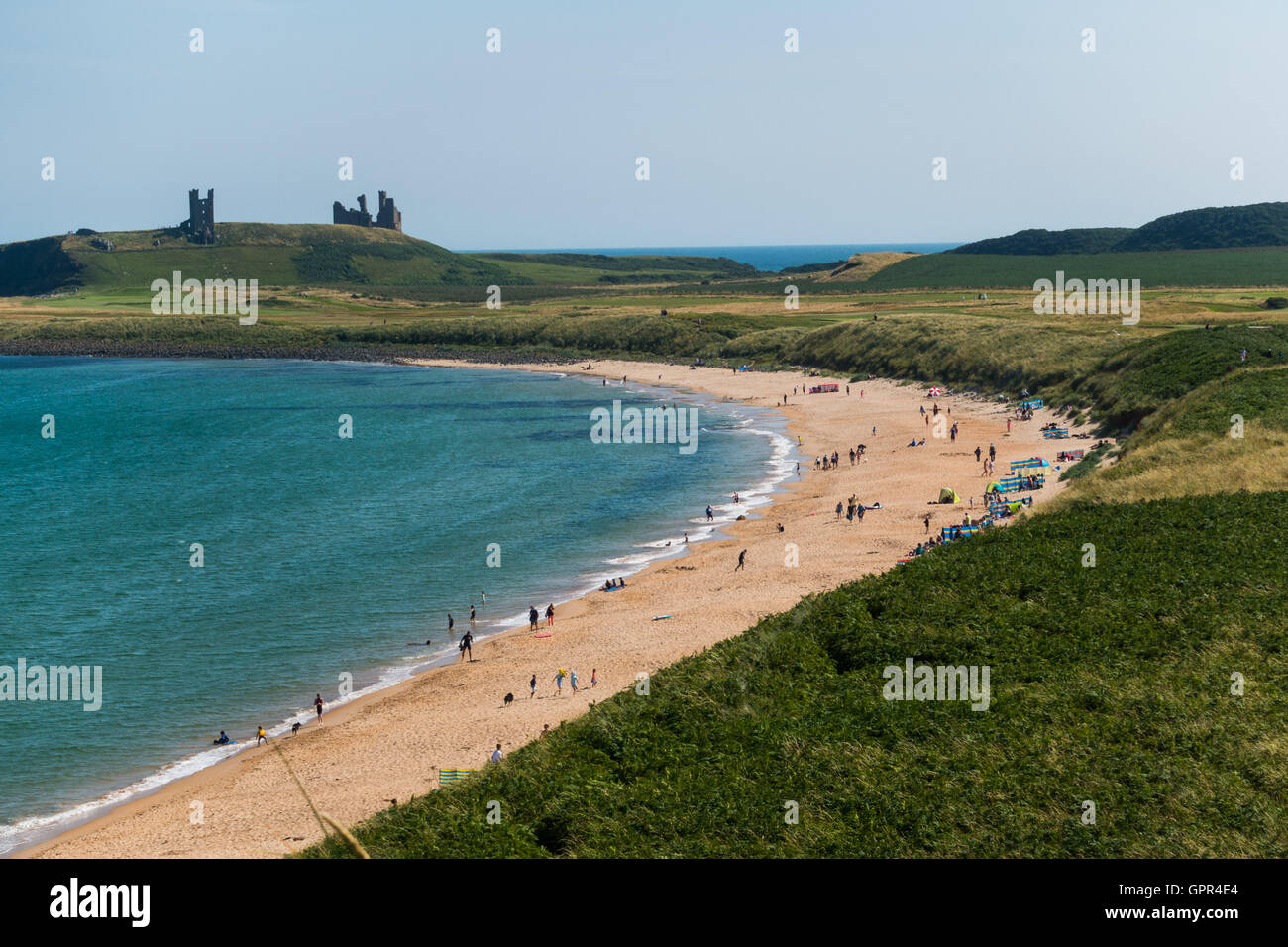 Embleton Bay and beach looking towards Dunstanburgh Castle, Northumberland - Stock Image
