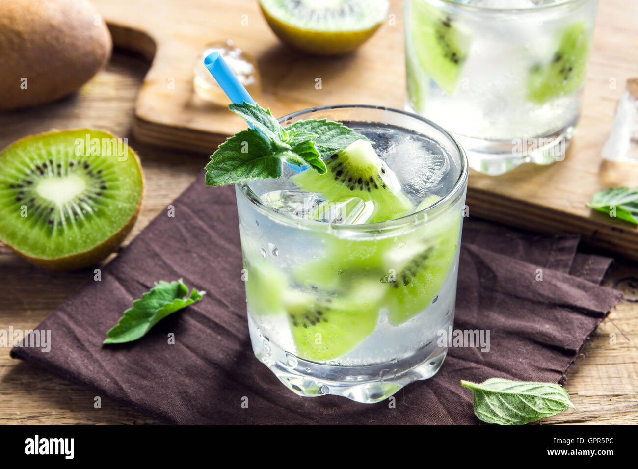 Kiwi drink (cocktail) with mint and ice in glasses close up Stock Photo