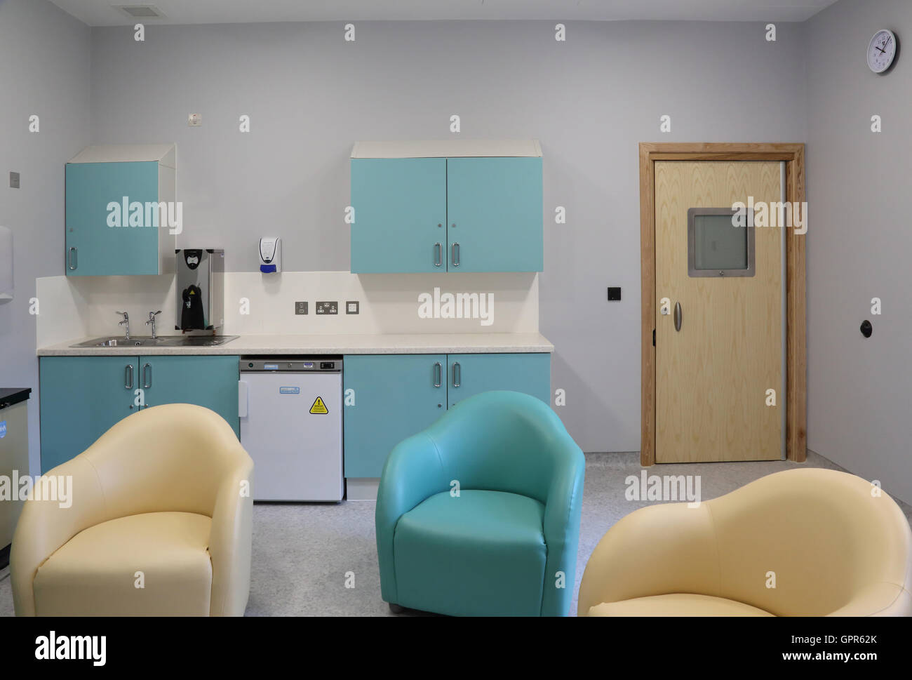 Visiting room in a new secure psychiatric hospital unit - shows specialist furniture and high-security door - Stock Image