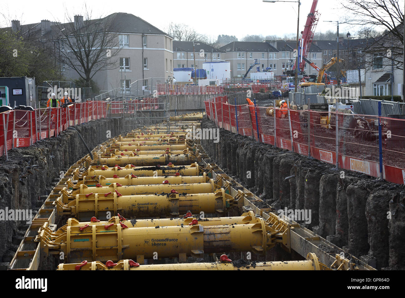 The excavation for new, large-diameter sewer through the Shield Hall district of Glasgow. Shows shoring and surrounding - Stock Image