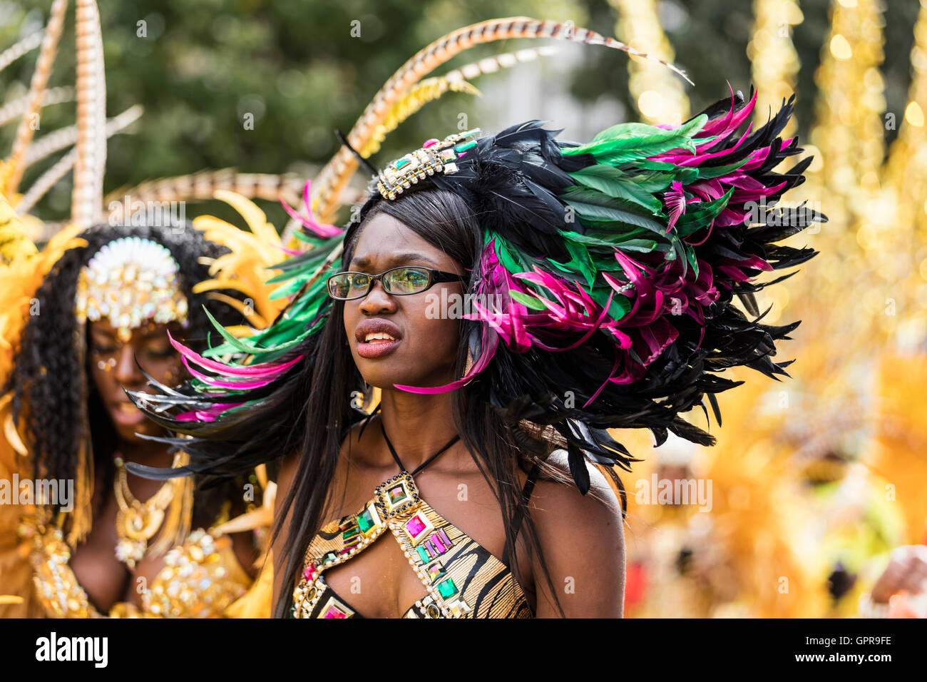 d25cbc55b9ef Young black girl wearing black glasses at the nottng hill carnival with a  red and green