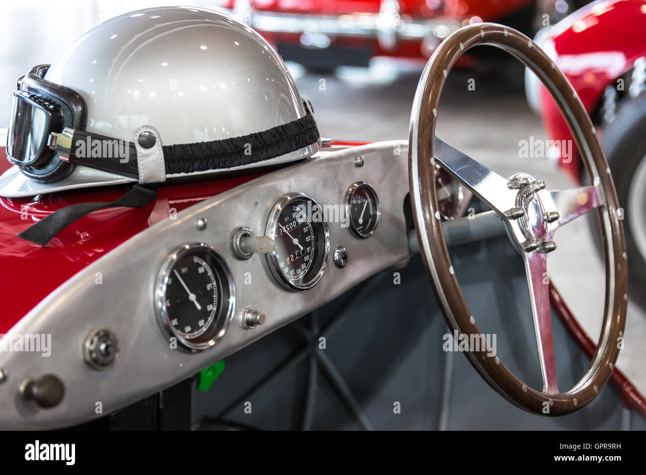 Helmet and glasses resting on a luxury convertible sports car. Stock Photo