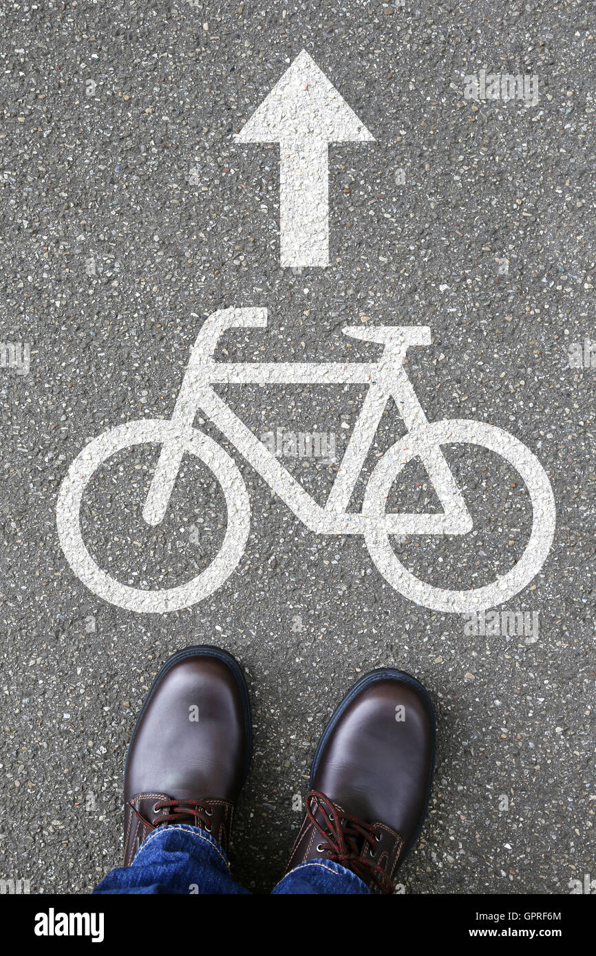 Man people bike lane path way bicycle road traffic city transport - Stock Image