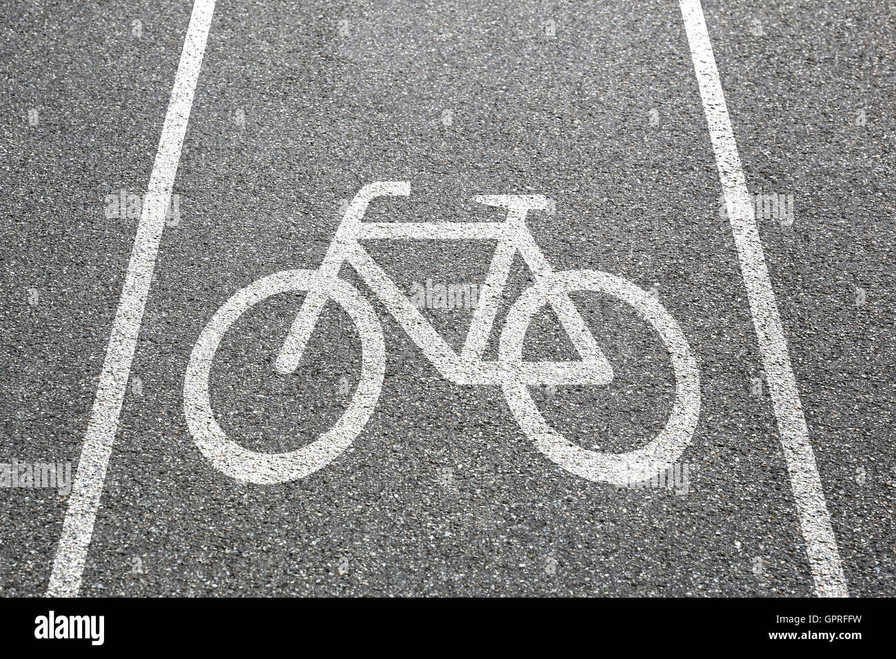 Bike lane path way cycle bicycle road traffic town city transport - Stock Image