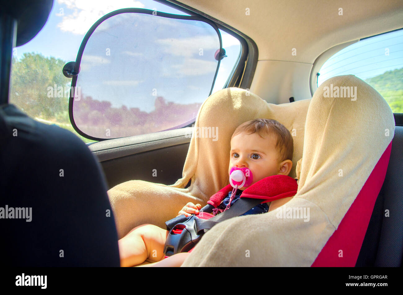 baby seat car curtains - Stock Image