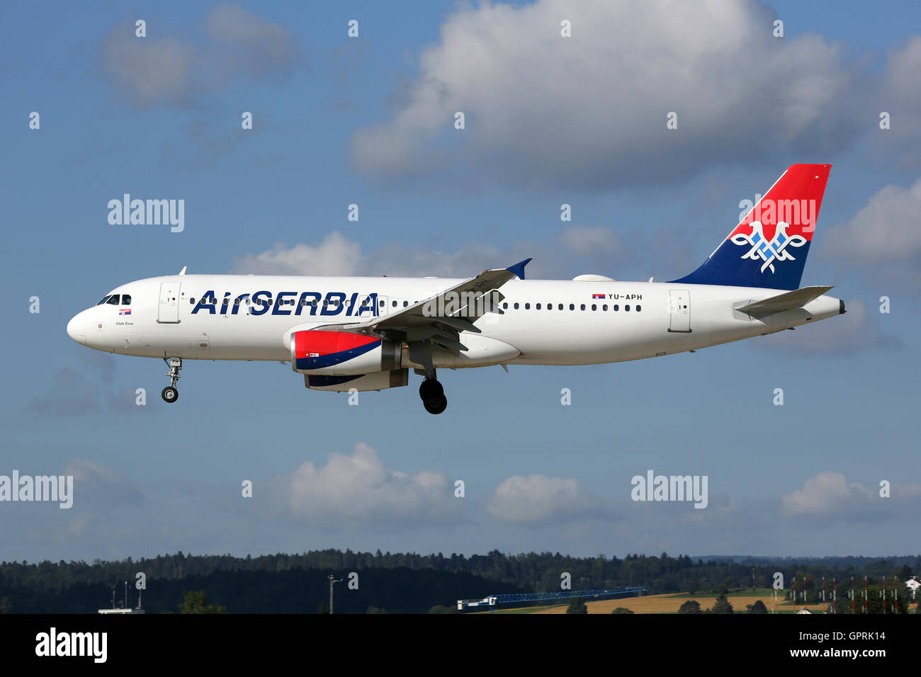 Zurich, Switzerland - July 29, 2016: An Air Serbia Airbus A320 with the registration YU-APH landing at Zurich Airport - Stock Image