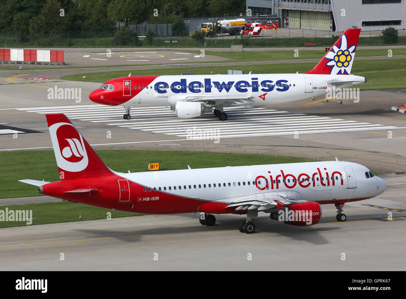Zurich, Switzerland - July 29, 2016: An Edelweiss Air Airbus A320 with the registration HB-IJU and Air Berlin at - Stock Image