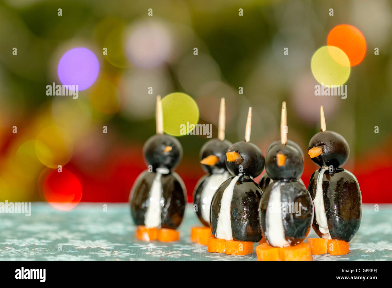 funny-looking penguins with olives, cheese and carrots - Stock Image