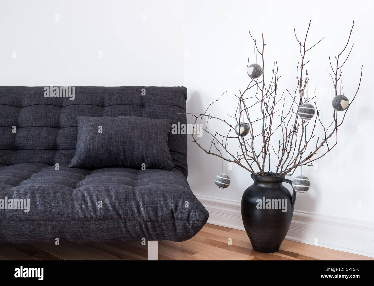 Gray sofa and simple winter decorations - Stock Image