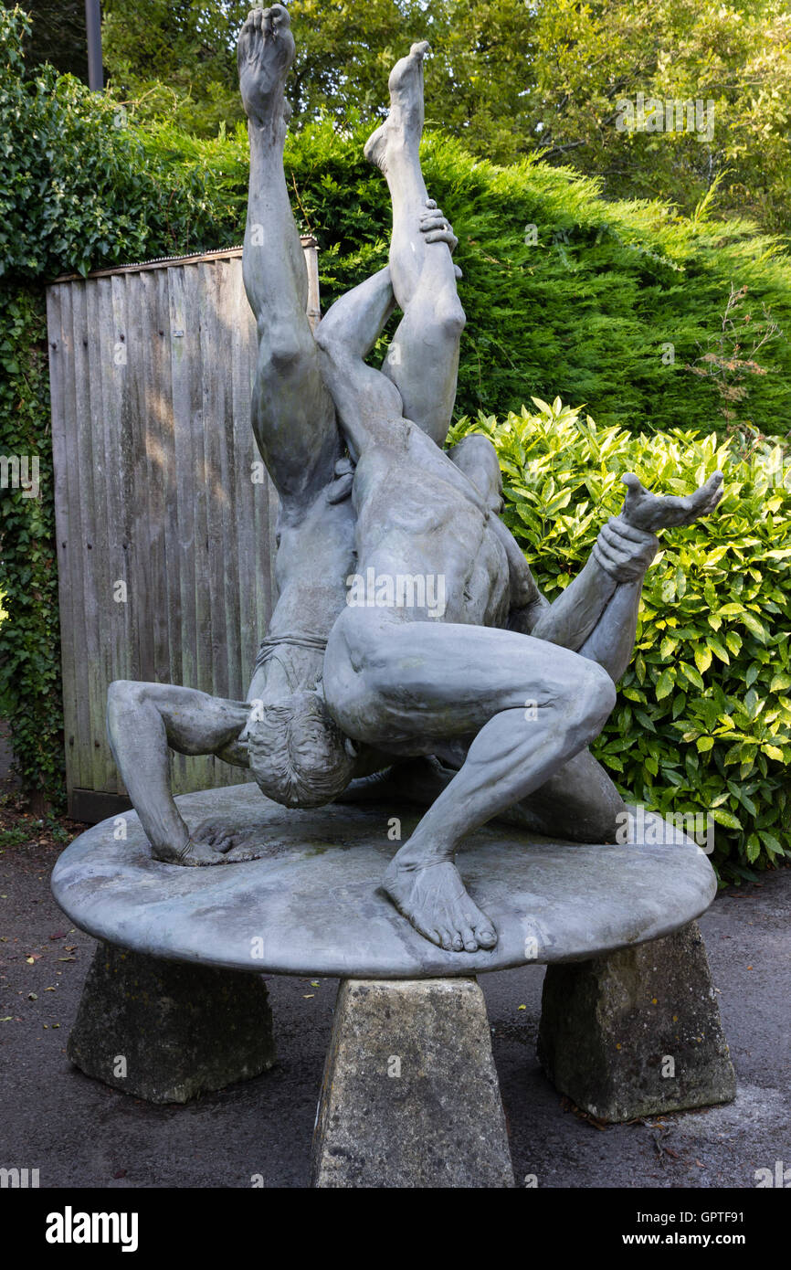 Male wrestlers sculpture in the grounds of the Abbey House Gardens, Malmesbury, Wiltshire, UK - Stock Image