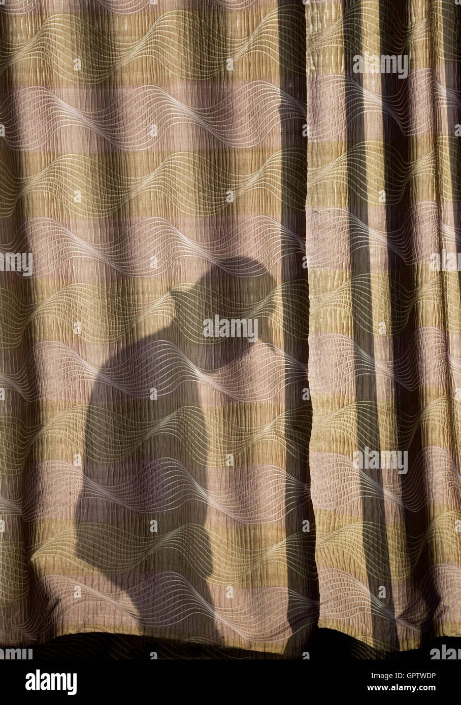 Stranger creeping around outside window - Stock Image
