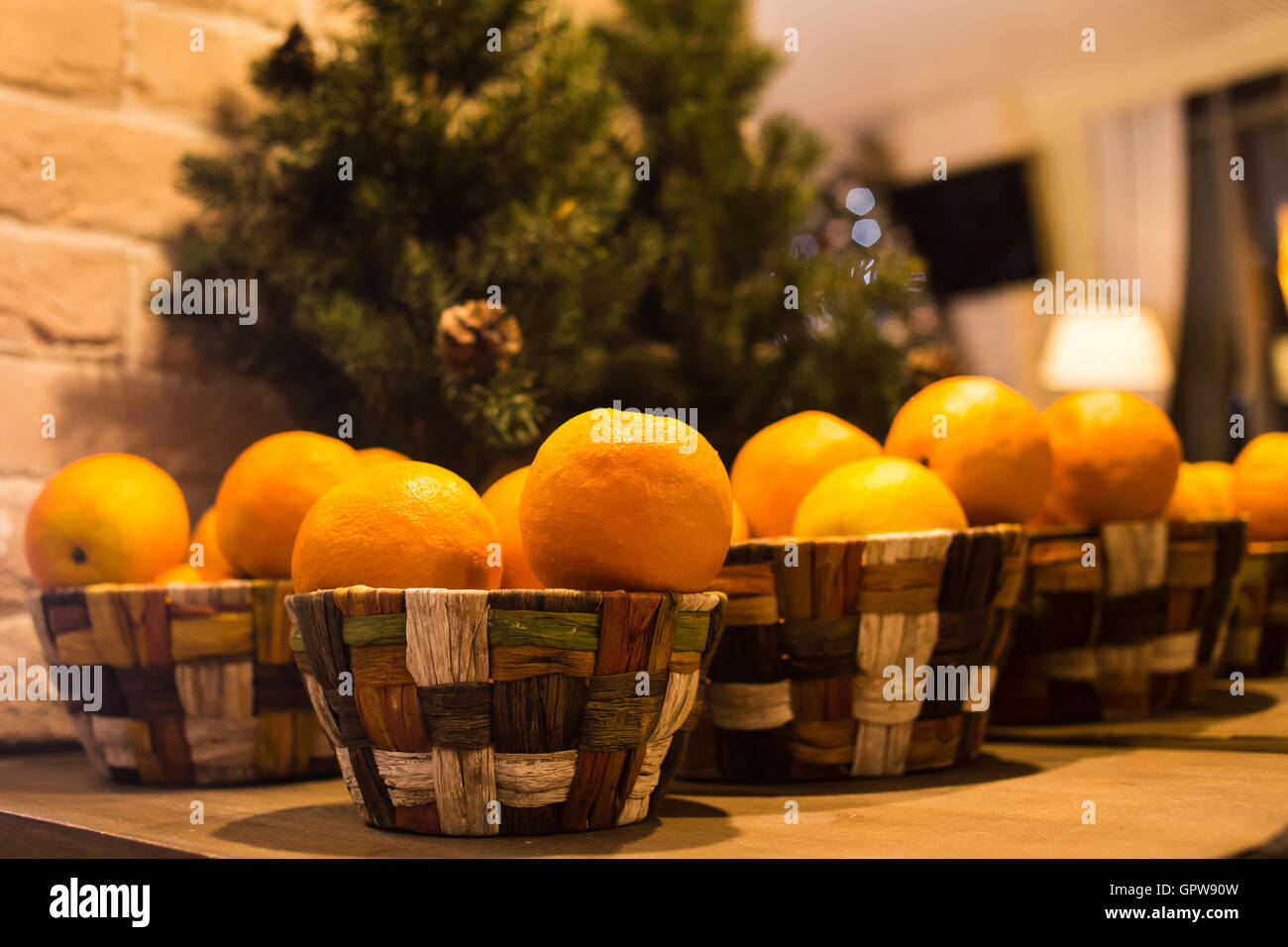 christmas new year composition with orange tangerines and fir branches on the wooden background in country style selective focus