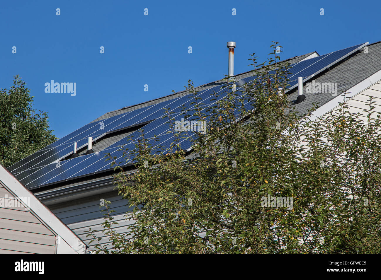 Solar panels installed on a roof of a private home. - Stock Image