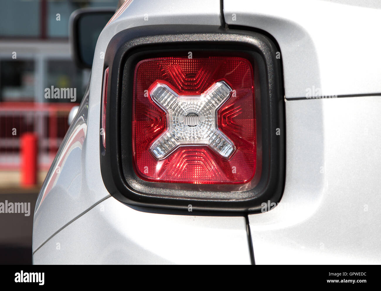 A closeup of a stoplight of an SUV. - Stock Image