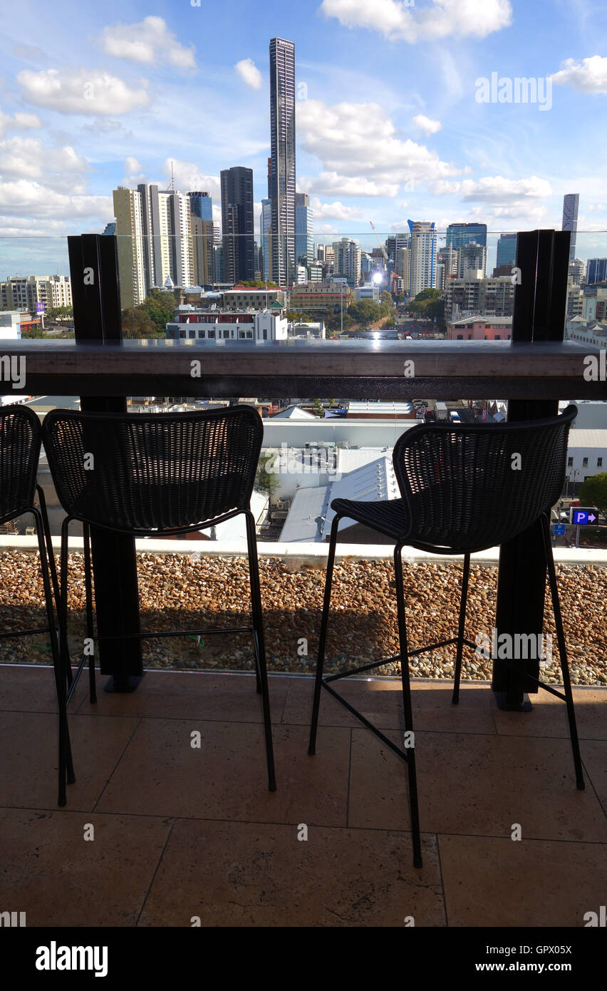 City skyline view and chairs at rooftop bar 'Eleven', Fortitude Valley, Brisbane, Queensland, Australia. - Stock Image
