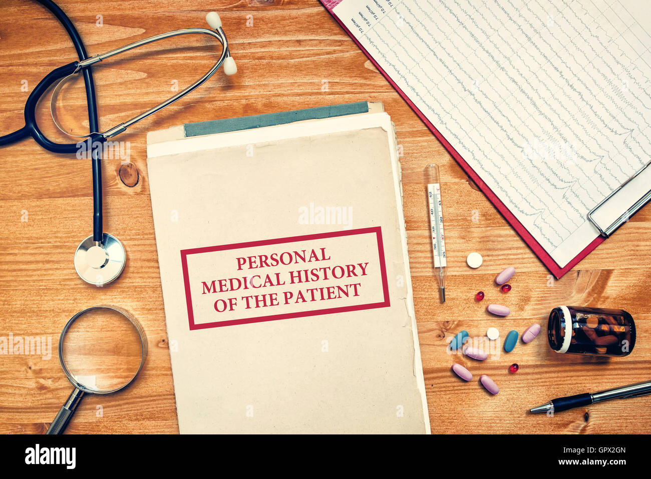 Personal medical history of the patient, healthcare concept with doctor's work space top view - Stock Image