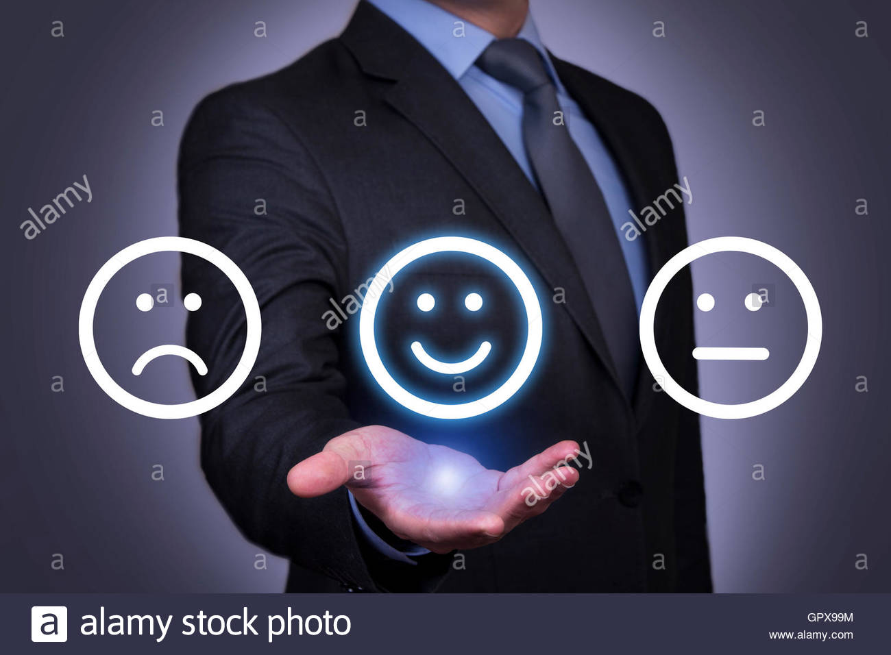 Happy Smileys Human Hand on Touch Screen - Stock Image