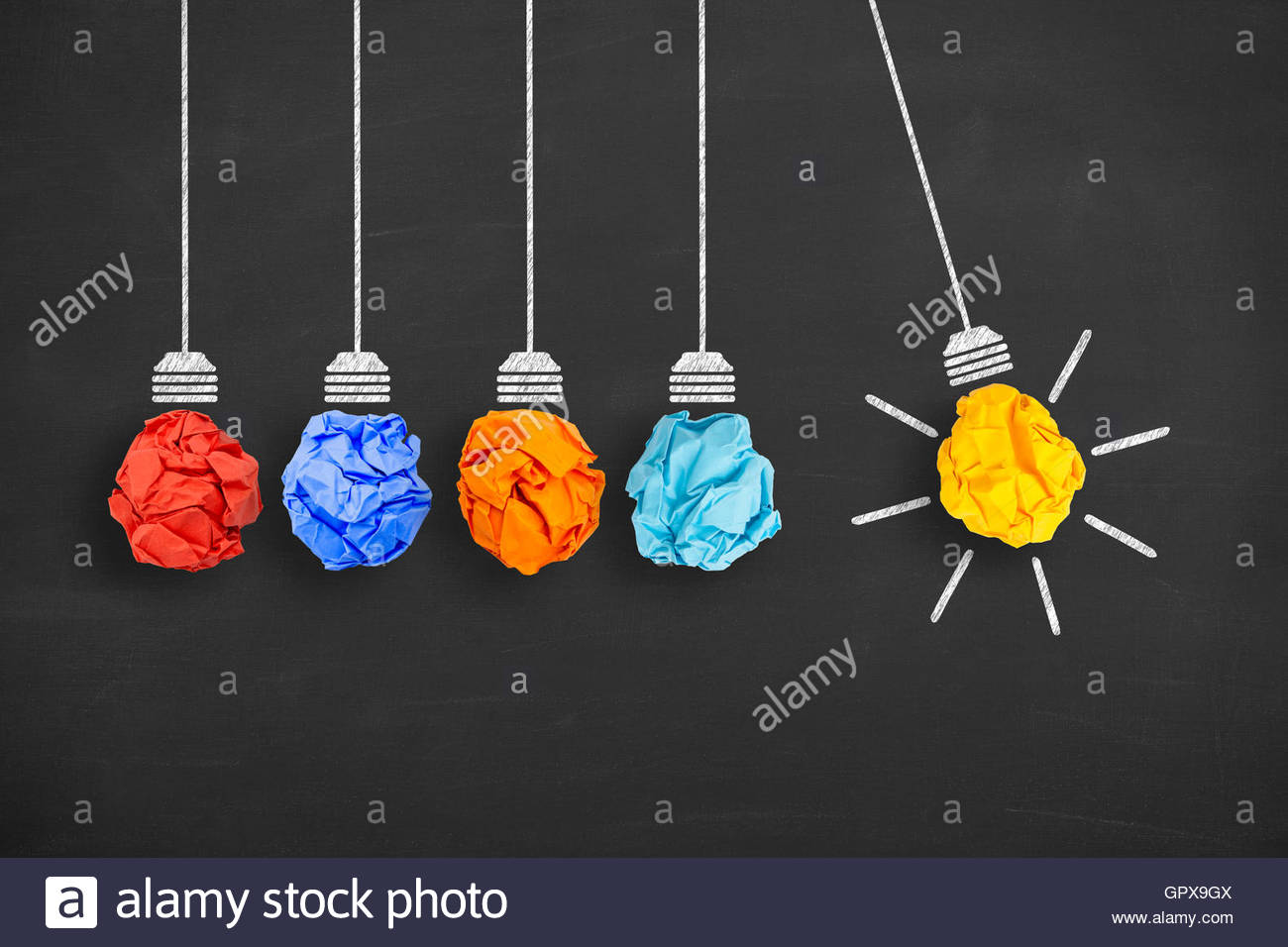 Idea Concept Light Bulb Crumpled Paper on Blackboard - Stock Image